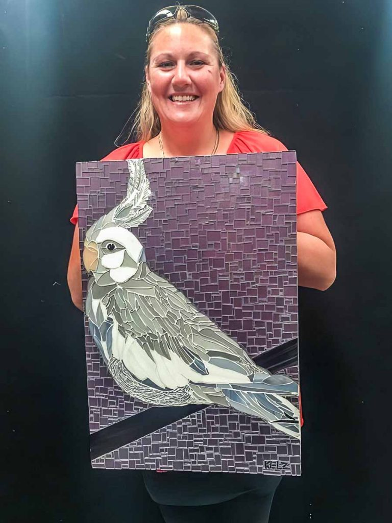 Kelly Brown and her cockatiel mosaic