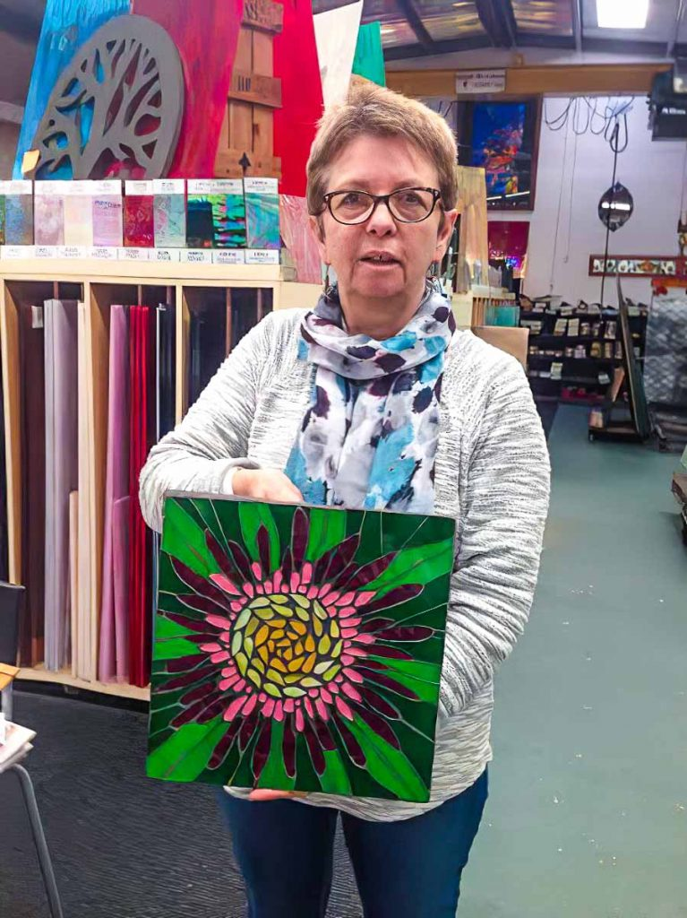 Artist: Maria Munro and her stained glass flower mosaic. Tuesday morning mosaic classes at The Glass Emporium