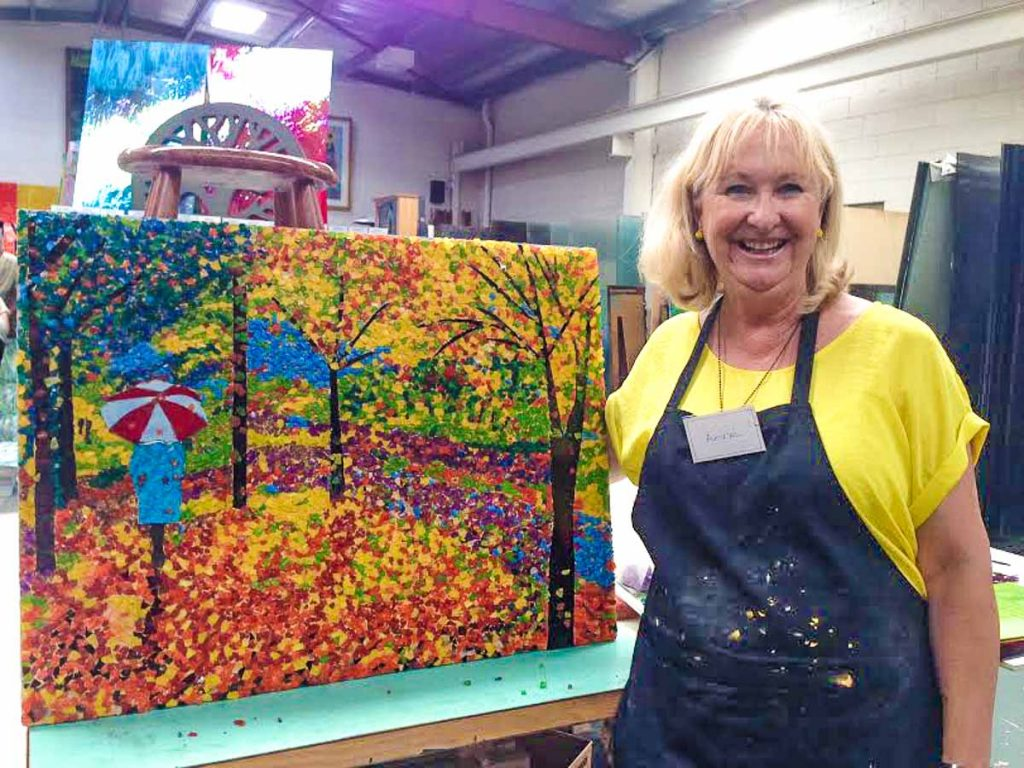 Artist: Anne Fuller  Anne with her completed Autumn mosaic