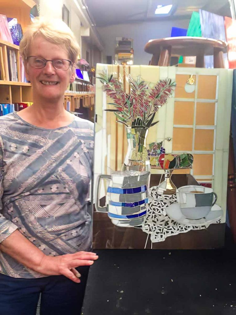 Artist: Lesley Shack Lesley and her completed still life mosaic