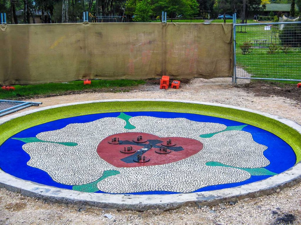 Hahndorf Water Feature 5m diameter vitreous glass and pebble Luther Rose design pond floor. Commissioned by District Council of Mount Barker