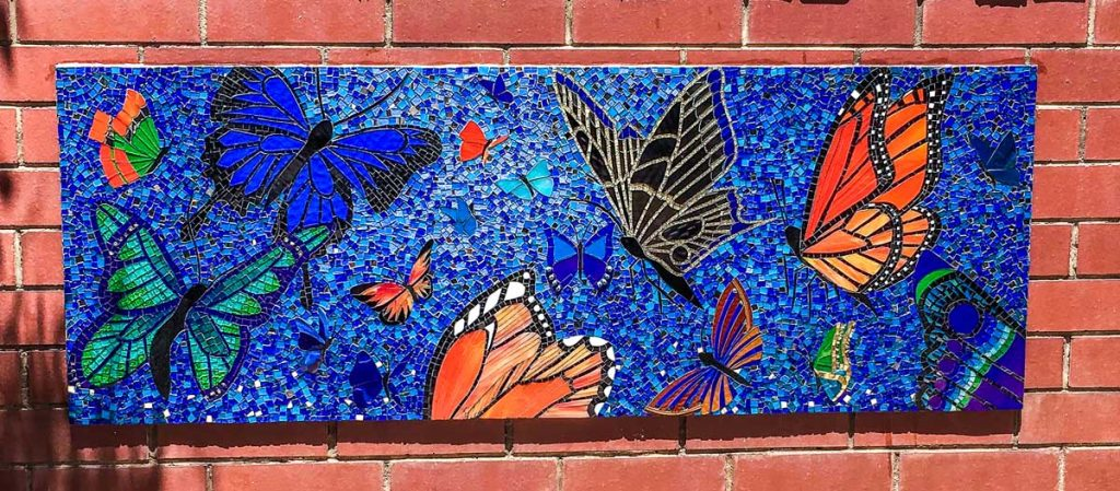 Butterfly Mosaic 1.6m x 0.65m stained glass butterfly mosaic. Commissioned by Magill Primary School