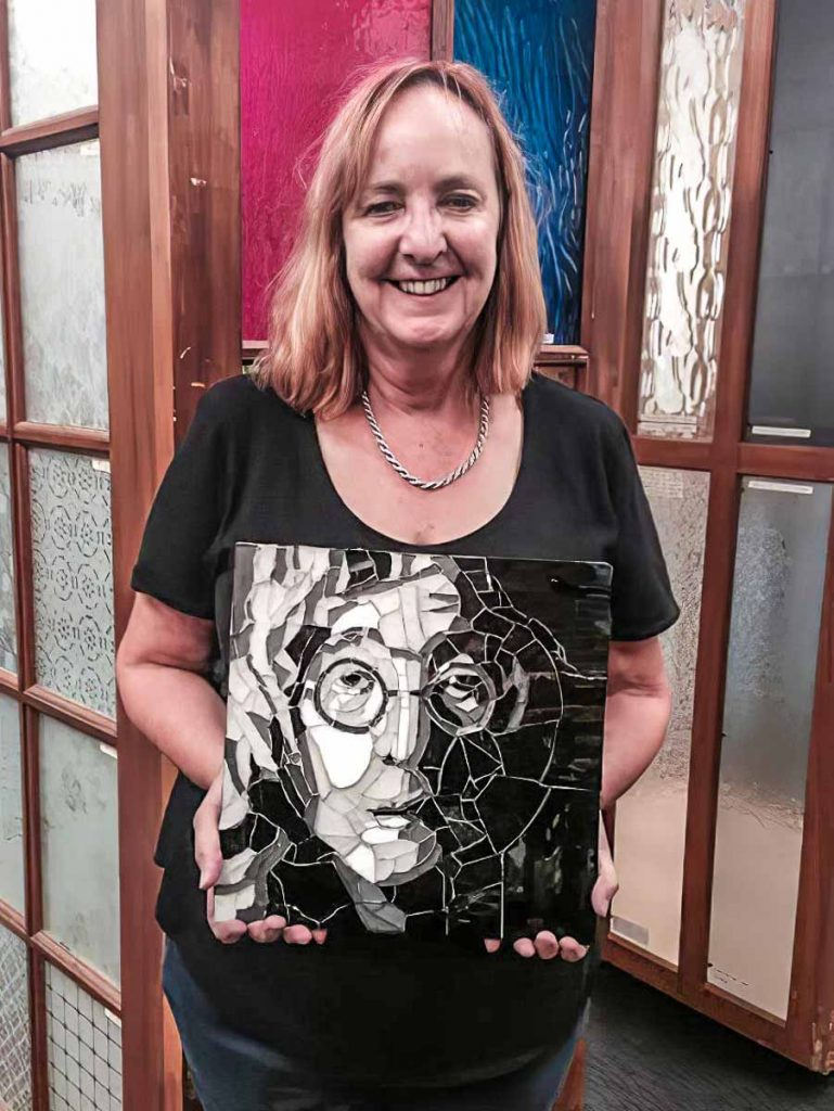 Leonie Duffy with her John Lennon portrait