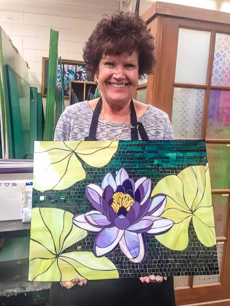 Marilla Ormond with her stained glass water lily mosaic