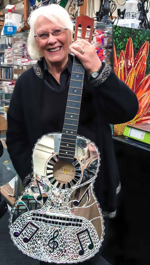 Glenys Heinrich: Mirror and stained glass mosaic guitar