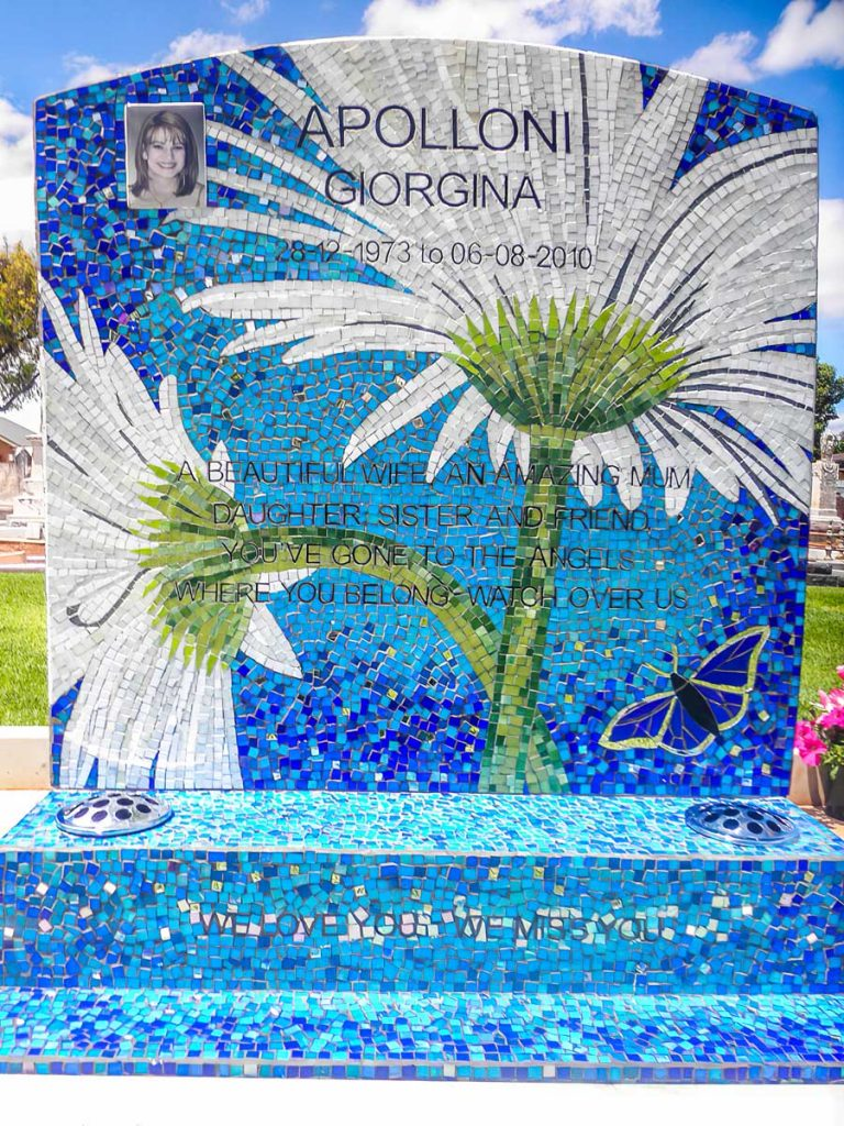 Gerbera Mosaic Memorial A memorial to Giorgina, a beautiful wife and mother who battled breast cancer for 6 years but never lost her smile. Her husband, Paul wanted a bright, happy place for their son Jake to visit.